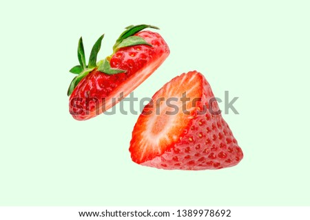 Strawberry. Cut strawberries into pieces. Strawberry slices flying in the air. Fresh natural strawberry isolated .  #1389978692