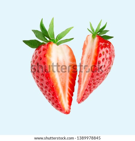 Strawberry. Cut strawberries into pieces. Strawberry slices flying in the air. Fresh natural strawberry isolated .  #1389978845