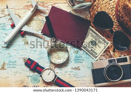 Flat lay of Traveler accessories and items man with backpack  for planning and visiting travel vacations on the world and working business for weekend.  Travel and Summer holiday concept #1390043171