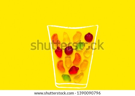 Creative food poster banner card template. Hand drawn chalk glass with fresh fruits juice imitated by gummy jelly candies on yellow background. Summer vitamins kids fun concept. Design element #1390090796