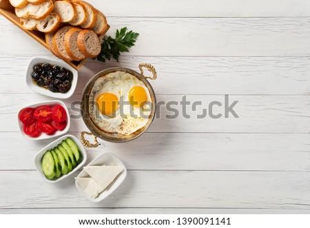 Turkish breakfast, Turkish style eye egg on copper field #1390091141