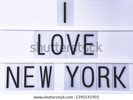"""Text """"I LOVE NEW YORK""""  written on white slate"""