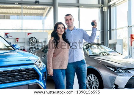 Happy family with keys from new car  #1390156595