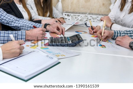 Group of people working with business graph in office #1390161539