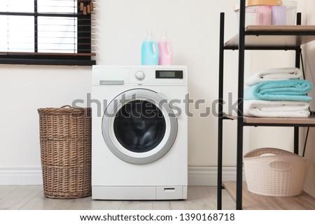 Modern washing machine in laundry room interior #1390168718