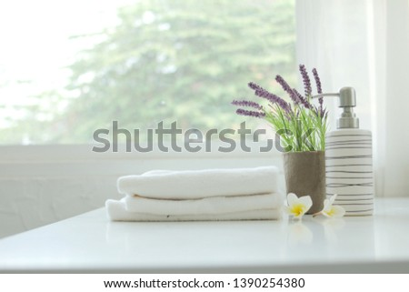 Soap bottle and white towel Put on a white table spa concept #1390254380