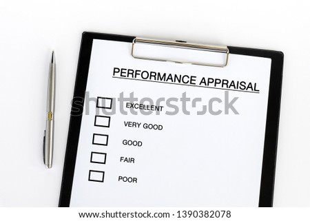 Performance Appraisal checklist on attached on Clip board and pen on white background #1390382078