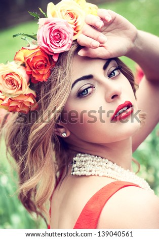 beautiful woman portrait outdoor with colorful flowers and red lips #139040561