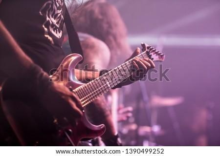 Musician, guitarist playing electric guitar #1390499252