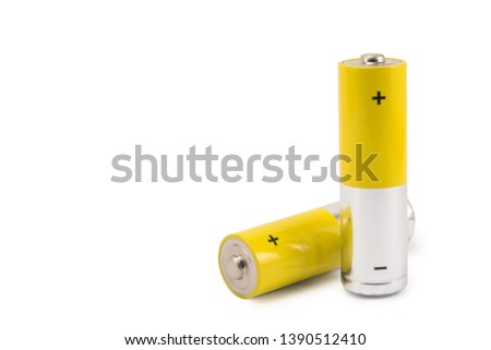 alkaline batteries and a yellow metal AA-size batteries isolated on white background closeup, carbon zinc batteries, rechargeable batteries, mockup #1390512410