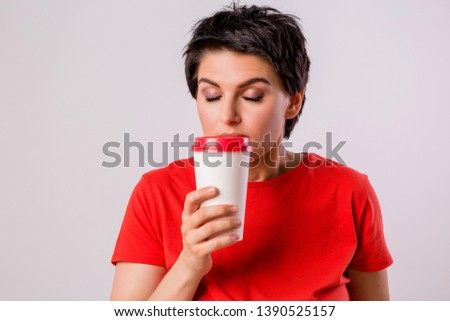 Close-up portrait of attractive pretty cute stylish cute cute cute funny brunette in everyday red t-shirt holding looking at paper Cup of coffee isolated on white background,concept of love for coffe #1390525157