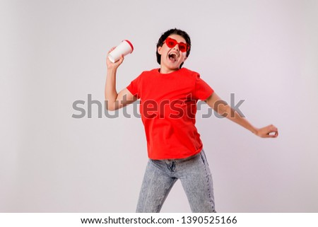 Close-up portrait of attractive pretty cute stylish cute cute cute funny brunette in everyday red t-shirt holding looking at paper Cup of coffee isolated on white background,concept of love for coffe #1390525166