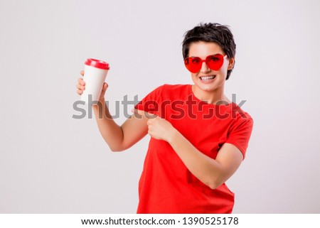 Close-up portrait of attractive pretty cute stylish cute cute cute funny brunette in everyday red t-shirt holding looking at paper Cup of coffee isolated on white background,concept of love for coffe #1390525178