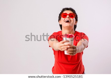 Close-up portrait of attractive pretty cute stylish cute cute cute funny brunette in everyday red t-shirt holding looking at paper Cup of coffee isolated on white background,concept of love for coffe #1390525181