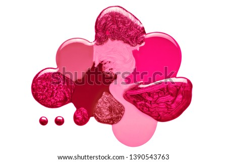 Artistic blend of different shades of pink and crimson nail polish in fused blobs giving an abstract globular form isolated on white in a fashion and beauty concept. Top view abstract design #1390543763