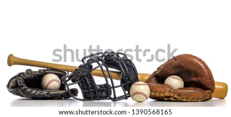 A group of vintage baseball equipment on a white background Royalty-Free Stock Photo #1390568165