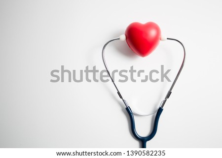 Red heart with stethoscope on white background, heart health, health insurance concept, world health day. #1390582235