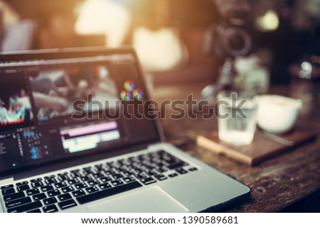 Close up laptop video cutting and grading color footage this is a lifestyle of Vlog or Blogger freelance and Selective focus at a laptop