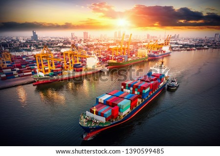 Logistics and transportation of Container Cargo ship and Cargo plane with working crane bridge in shipyard at sunrise, logistic import export and transport industry background #1390599485