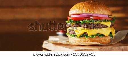 double cheeseburger with lettuce, tomato, onion, and melted american cheese with panoramic composition #1390632413