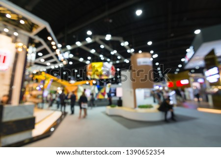 Abstract blur people in exhibition hall event trade show expo background. Large international exhibition, convention center, MICE industry business concept #1390652354
