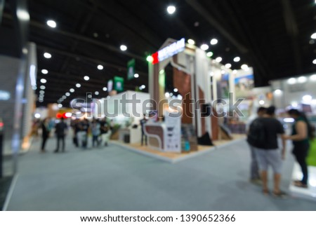 Abstract blur people in exhibition hall event trade show expo background. Large international exhibition, convention center, MICE industry business concept #1390652366