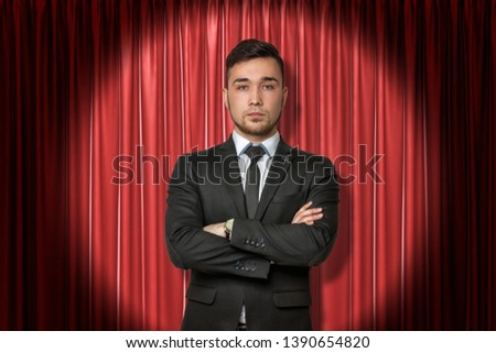 Young businessman on red stage curtains background. Digital art. Fame and glory. Business and commerce. #1390654820