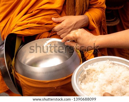 The monks of the Buddhist Sangha (give alms to a Buddhist monk), which came out of the Buddhist offerings in the morning. The tradition of giving alms to monks in Thailand. #1390688099