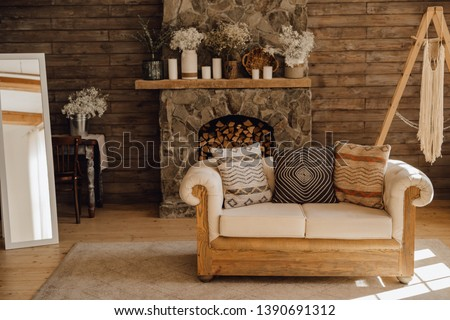 Chalet Cozy Interior Wooden Sofa and Fireplace. Rustic Home Design for Warm Indoor Space Alpine Vacation. Modern Cottage Living Room Decor with Wood Wall and Furniture. Winter Holiday Background #1390691312