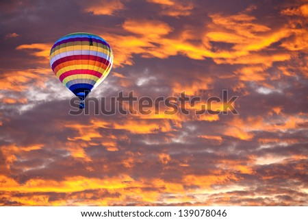Balloon on Sunset / sunrise with clouds, light rays and other atmospheric effect #139078046