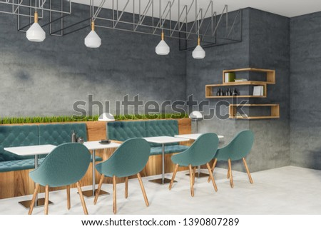 Corner of modern restaurant with concrete walls, white floor, square white tables and comfortable blue sofas and chairs. Wooden shelves with books and bottles. 3d rendering #1390807289