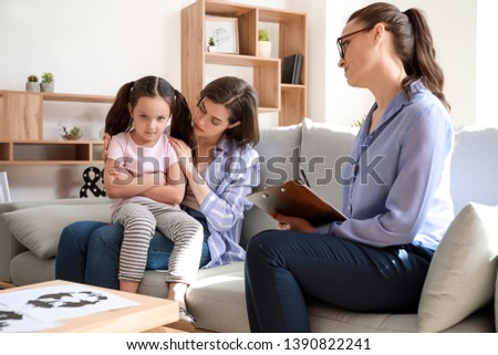 Mother with naughty little daughter in psychologist's office #1390822241