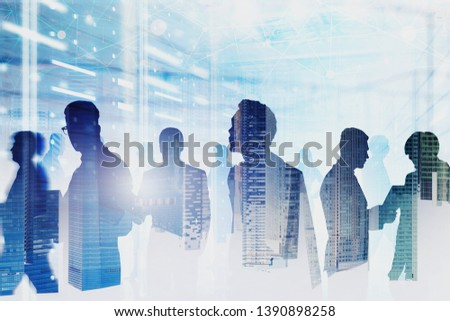 Diverse team of computer engineers in server room interior double exposure of cityscape and network hologram. Concept of big data and cloud computing. Toned image blur #1390898258