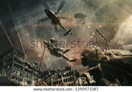Military helicopter and forces between fire and smoke in destroyed city and soldiers are in flight with a parachute to reach battlefield/A soldier looks at them #1390973387