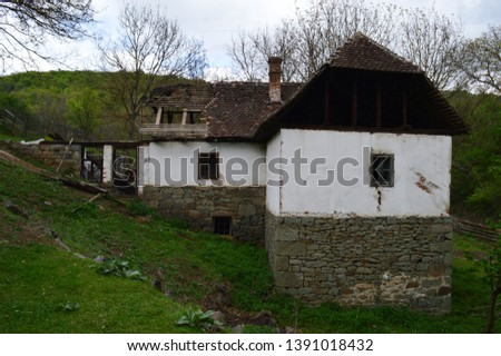 an old abandoned ruined house #1391018432