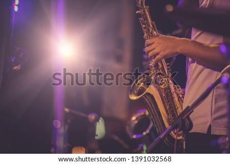jazz musician playing the saxophone #1391032568