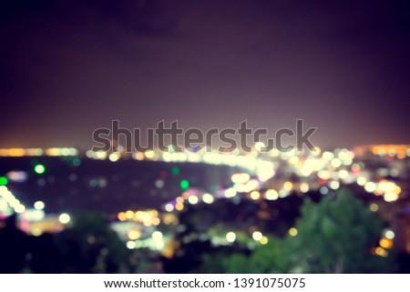 Blur defocus bokeh of light in the city with dark background #1391075075