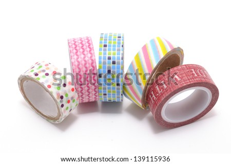 Washi Tape, a high quality masking tape made of rice paper, isolated on white background. Is beautiful yet useful at the same time. You can tear it, stick it, reposition it, or write on it. Royalty-Free Stock Photo #139115936