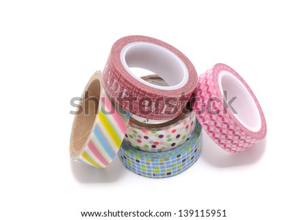 Rolls of Washi Tape isolated on white background. Is a decorative handmade paper with a traditional Chinese method that was introduced in Japan by a Korean Buddhist priest. Royalty-Free Stock Photo #139115951