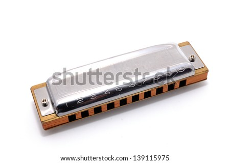 Harmonica, also French harp, blues harp, and mouth organ, isolated on white background. Is a free reed wind instrument used worldwide in blues, American folk  music, jazz, country, and rock and roll. Royalty-Free Stock Photo #139115975