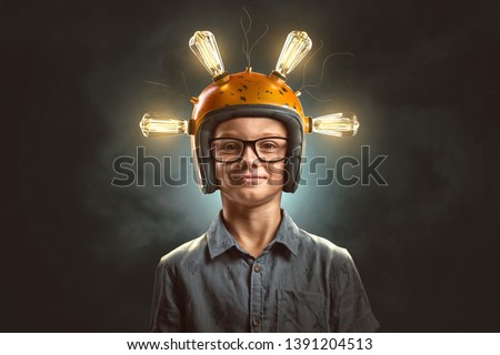 Clever kid with light bulb helmet  #1391204513