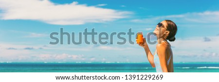 Healthy juice detox happy woman drinking carrot juicing smoothie glass on summer sunny day vacation background banner panorama. Copy space on blue sky. #1391229269