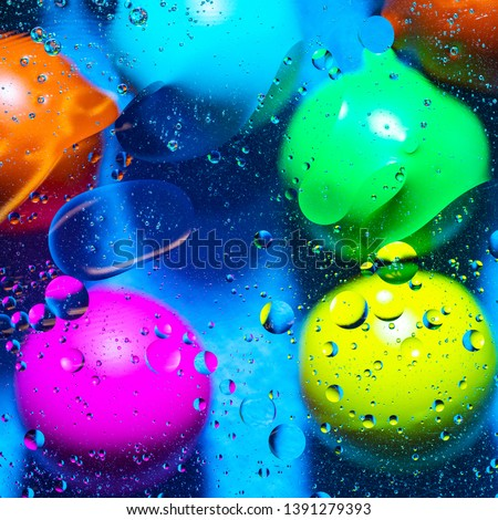 Mixing water and oil on a beautiful color abstract background gradient balls circles and ovals  #1391279393