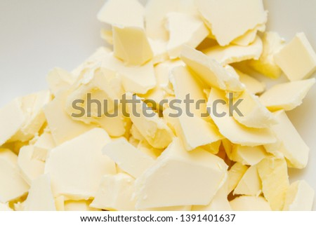 Pieces of butter are in a bowl for mixing in the preparation of cookies #1391401637