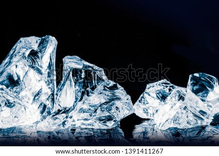 Pieces of crushed ice cubes on glossy black surface. Clipping path included. #1391411267