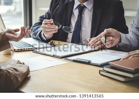 Business woman explaining about his profile to two selection committee manager sitting in during job Interview, interview the job and hiring. #1391413565