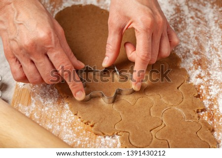 Christmas - preparing homemade gingerbread for the holidays #1391430212
