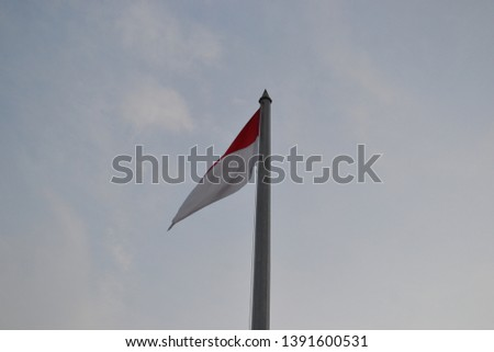 beautiful photo of Indonesian flag in the sky #1391600531