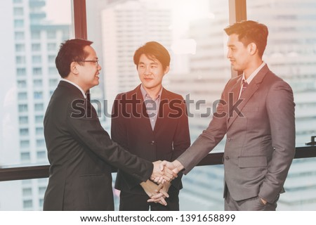 Business Middleman,Project Done with Connection Agent Man Concept,Three Business man Shake hands #1391658899