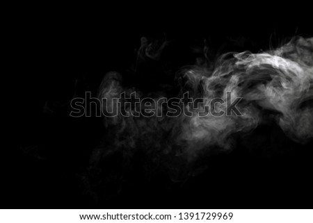 Abstract powder or smoke effect isolated on black background #1391729969